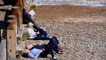People enjoying the warm weather along the coast of Southwold. Picture: NICK BUTCHER