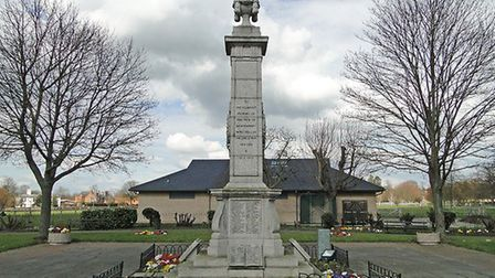 Newmarket War Memorial stands at the top of the High Street in the Memorial Gardens. It bears the n