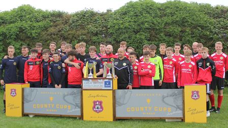 Walsham-le-Willows Under-14s and Under-16s pictured with their two trophies at Suffolk Youth Cups fi