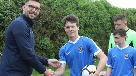 George Ablitt pictured with Suffolk FA chief executive Richard Neal and the match ball after scoring
