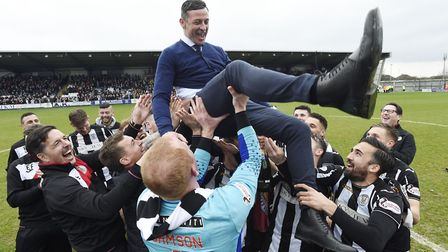St Mirren players throw manager Jack Ross up in the air as they celebrate winning the Scottish Champ