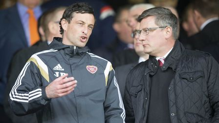 Ross (left) during his time as a coach at Hearts and Director of football Craig Levein. Picture: PA