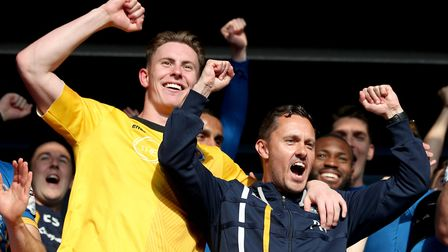 Hurst (right) celebrates with goalkeeper Dean Henderson after his side beat Charlton on Sunday to re