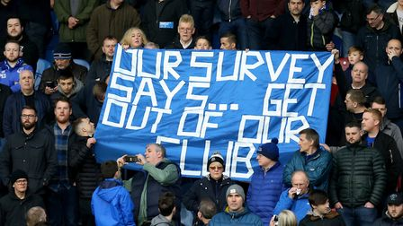 Everton fans with a banner in the stands that says 'Our Survey Says... Get Out Of Our Club' during t