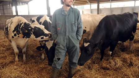 Jonathan Crickmore stands with his cows Picture: SU ANDERSON