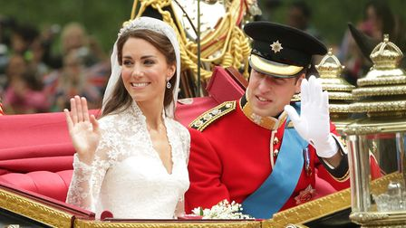 Prince William and his bride Kate travel down The Mall after being married at Westminster Abbey in