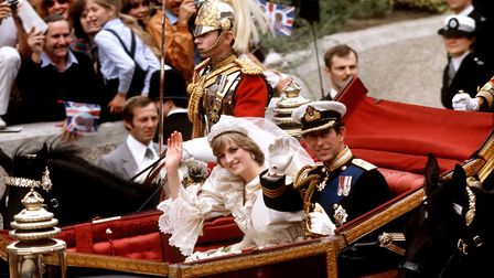 The Prince of Wales and his bride, the Princess of Wales, make their way to Buckingham Palace in an
