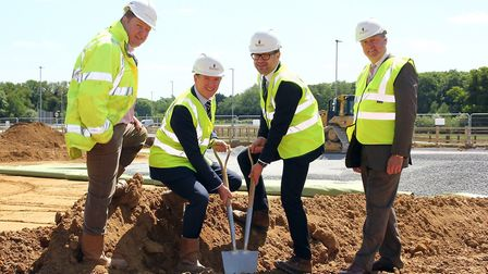 From left, Jeremy Ault – Pick Everard, Mark Bailey – Barnes Construction (holding spade), Ole Held –