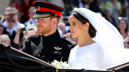 Meghan Markle and Prince Harry leave St George's Chapel at Windsor Castle after their wedding. Pictu