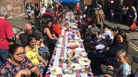 Bathed in sunshine, they got together for a big game of pass the parcel as part of the celebrations