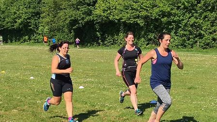 A trio of female runners enjoy the sunny conditions at the 11th staging of the Haverhill parkrun. Pi