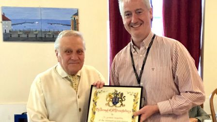 Ernie Broom (left) is presented with his scroll by town and borough councillor Paul Hopfensperger. P