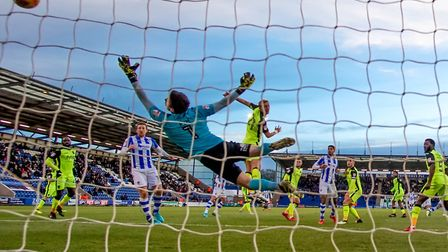 Sammie Szmodics (far right, partly hidden) scores the U's third goal in the 3-1 home win over today'