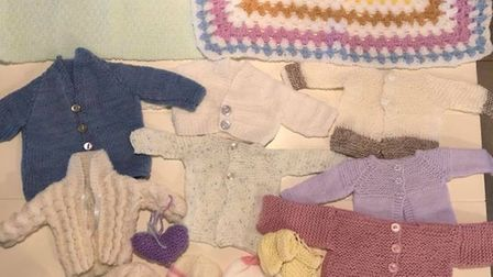 Some of the donated knitted items. Picture: Warm Baby Project