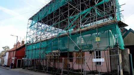 The pub has been covered in scaffolding for much of the time since the fire. Picture: SIMON PARKER