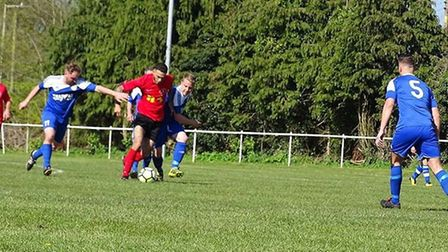 Leiston St Margarets' Taylor Bannister runs at the AFC Hoxne defence. Picture: BETH COOPER