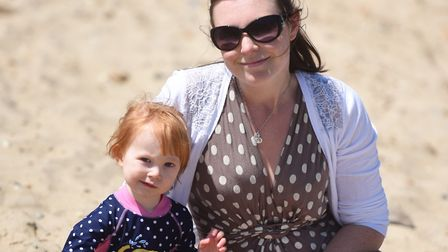 Hot weather in Felixstowe bring out thousands of beach goers. Left to right, Eliza and Sara Gilbert.