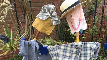 Deterrents - Wil's scarecrow is on the left, protecting his strawberries, George's is on the right,