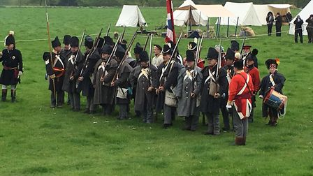 The British soldiers firing rounds in the 95th Rifles Regiment of Foot's re-enactment of the Battle