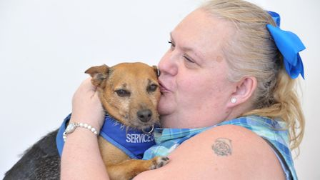 Elaine Arnold with her service dog, Holly. Picture: SARAH LUCY BROWN