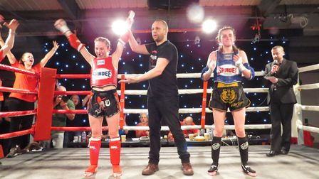 Tamzin Raison, left, celebrates victory in a fine showing at the Unit 1 Fight Night. Picture: LAURA