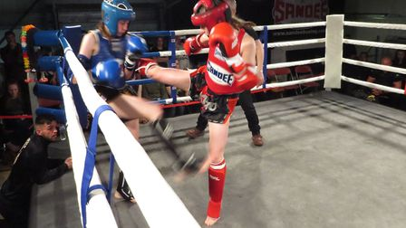 Tamzin Raison thuds a round kick into her foe at the Unit 1 Fight Night. Picture: LAURA KAEWMALA