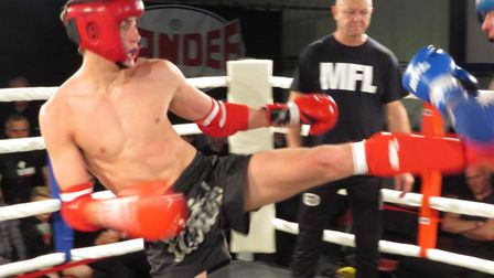 Jake Nichols lands a kick on his way to a win at the Unit 1 Fight Night. Picture: LAURA KAEWMALA