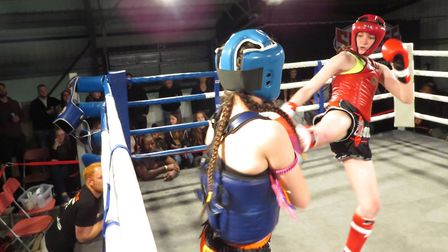 Lottie King lands a kick on her way to victory at the Unit 1 Fight Night. Picture: LAURA KAEWMALA