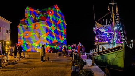 Visitors watch the Tide Mill lit up for the Beowulf Festival. Picture: CHRIS MAPEY