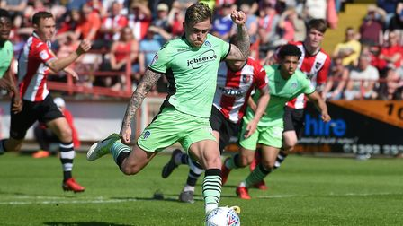 A season of near misses: Leading scorer Sammie Szmodics has this second-half penalty saved by Exeter