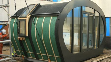 A wooden lodge is installed into the new Time Garden at Colchester Hospital. Picture: COLCHESTER HOS