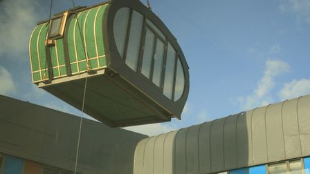 A wooden lodge is lowered into the new Time Garden at Colchester Hospital. Picture: COLCHESTER HOSPI