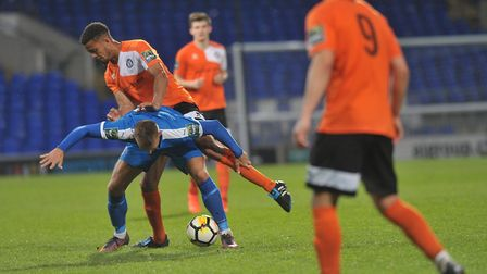 Midfield action at Portman Road in the Suffolk Premier Cup final on Wednesday night.