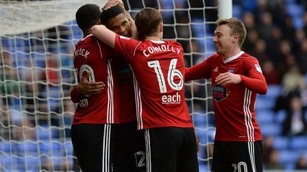 Jordan Spence is congratulated for his goal at Reading Picture Pagepix