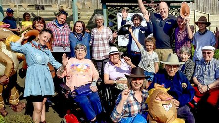 Staff, visitors and carers at the country and western party held at Care UK's Mills Meadow in Framli