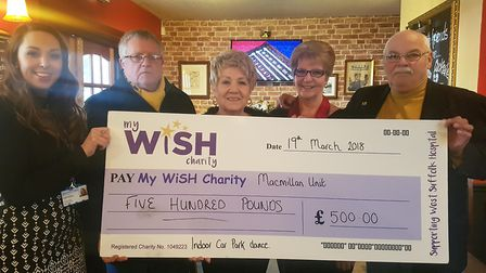Amy Hatch, fundraising officer for the My WiSH Charity, receives a cheque for £500 from John Brooks,