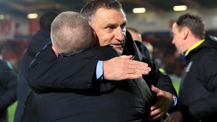 Blackburn Rovers manager Tony Mowbray celebrates his team sealing League One promotion at Doncaster.