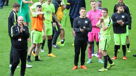 Gym United players and management applaud their fans following their 2-0 defeat in the FA Sunday Cup
