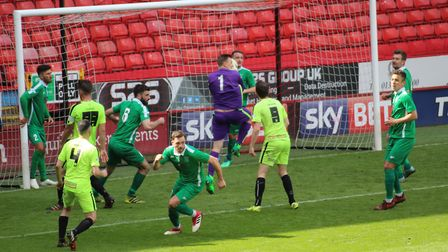 Hardwick Social goalkeeper Michael Arthur catches the ball from a Gym United corner in the second ha