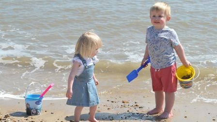 Lily and Isaac enjoy a paddle on the beach at Felixstowe earlier this month when temperatures were i