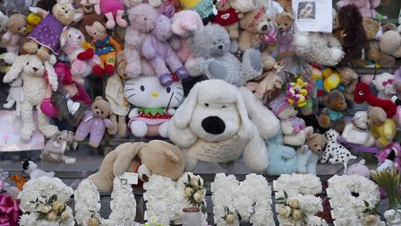 Teddy bears and flowers left in memory of seven-year-old Summer Grant, who was fatally injured when
