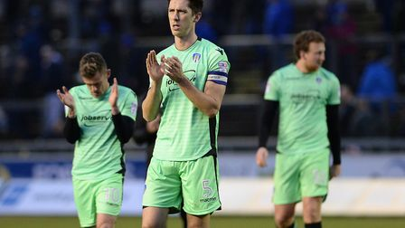 A disappointed Luke Prosser applauds the U's away fans following the 1-1 draw at Carlisle from Febru