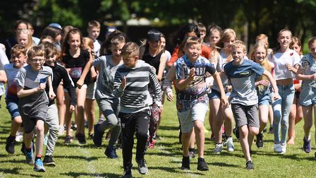Children at Heath Primary School in Ipswich get active for the Daily Mile. Picture: GREGG BROWN