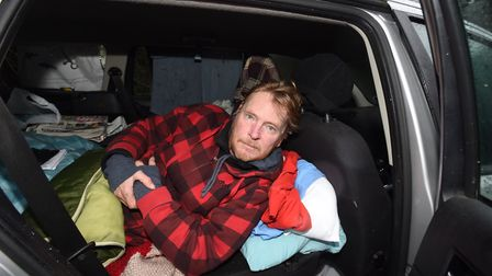 Mr Wallace in his car, where he lived for over six months. Picture: GREGG BROWN