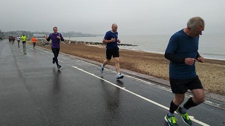 Runners toil in the testing conditions along the promenade at Felixstowe. Picture: FELIXSTOWE PARKRU
