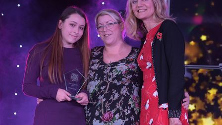 Elysha Young won carer of the year in 2017 - here she is receiving her award. Picture: SARAH LUCY