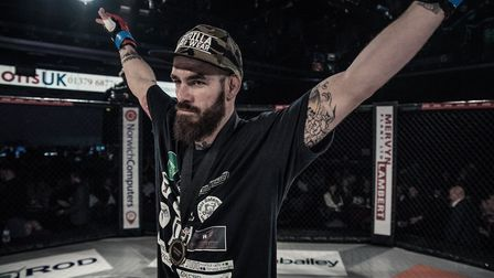 Scott Butters celebrates his win in the main event of Contenders 23. Butters is now 2-0 as a pro lig
