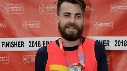 EHAAT London Marathon runner Jack Newman from Maldon with his London Marathon finisher medal. Pictur