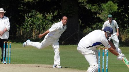 Woolpit bowler Barry Collins, who took the important wicket of Brendon Louw and later scored the win