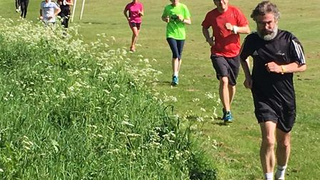Runners skirt the football pitches during the sixth staging of the Great Dunmow parkrun. {icture: CA